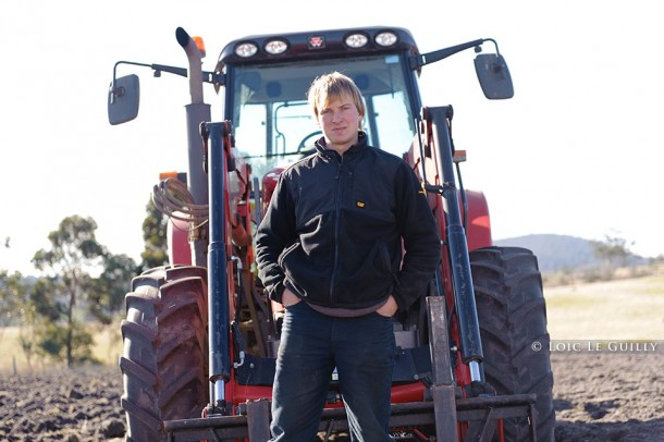 photo of a farmer in front of his tractor in Tasmania